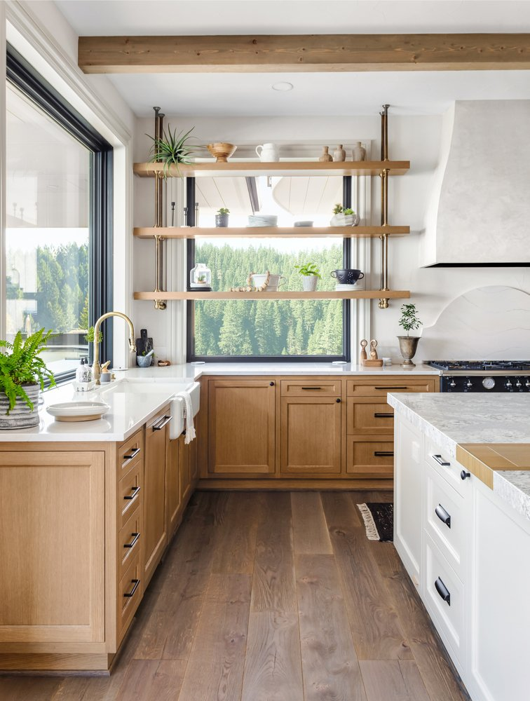 natural themed kitchen with plants, granite countertops and wood cabinets